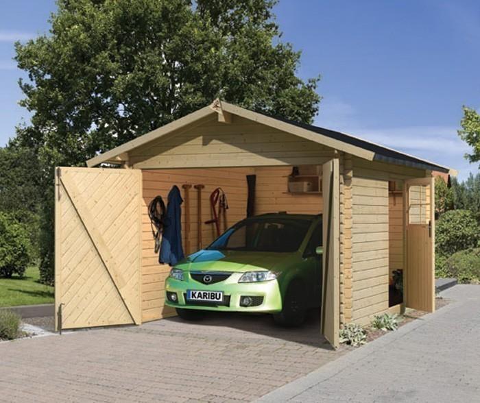 garage mit tor blockbohlenhaus 40mm karibu 387x537cm natur bei. Black Bedroom Furniture Sets. Home Design Ideas